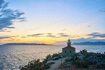Amazing sea bay with  old lighthouse on sunset in Makarska, Croatia
