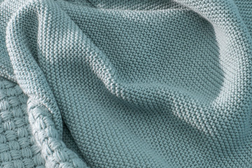 Knitted blue green color fabric is soft with a nice drape and stretch