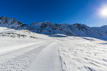 Ski slopes and ski lifts in the Alps.