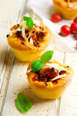 pizza muffins bolognese sauce. selective focus