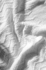 Texture, background, pattern. Women's woolen white winter sweater