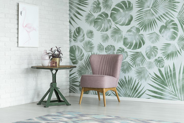 Floral room with pink chair