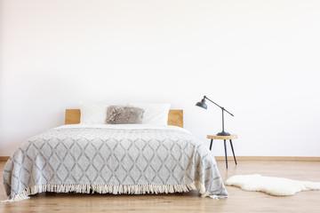 Patterned blanket on king-size bed