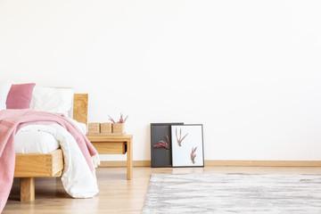 DiY posters in pink bedroom