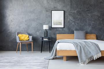 Wooden bed in dark bedroom