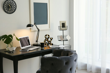 Interior of beautiful modern room with comfortable workplace