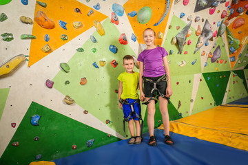 Adorable little children in climbing gym