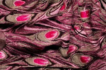 Texture, background, pattern. Woolen women's sweater, sweater pattern of peacock feathers