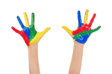 Child's hands in paint on white background