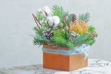 Cotton plants and wooden reindeers in Christmas festive table decoration
