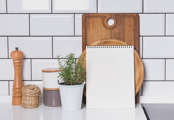 Blank paper mock-up in modern kitchen interior with white tile brick wall and wooden boards