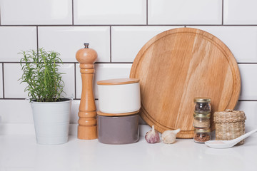 Herbs and spices on the  background of white brick tile wall.