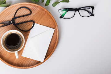 Coffee, scissors and glasses on the white background