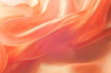 Texture, background, pattern. Orange Silk Fabric for Drapery Abstract Background. Abstract Fabric Flame Background, Artistic Waving Cloth Fractal Pattern