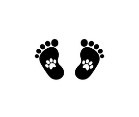 Animal pawprints inside of baby footprints.