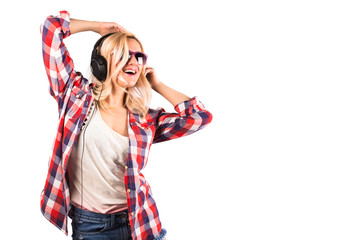 Happy pretty woman having fun with headphones against white background.