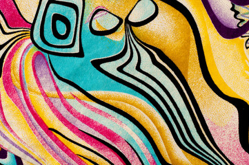 Background texture, drawing. Silk fabric. Cloth with bright stripes of colored patterns, abstract image.