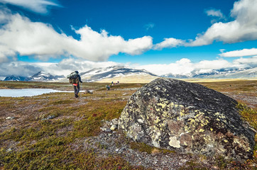 Thyrists in the mountains. People in camping equipment. Sweden, Lapland, Sarek National Park
