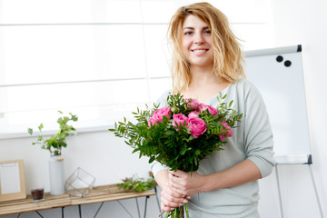 Picture woman of florist composing bouquet