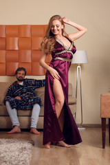 Picture of dancing blonde in long negligee and men in dressing gown