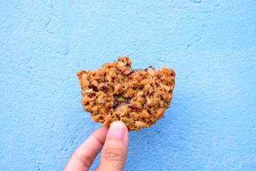Hand holding a bite cookie