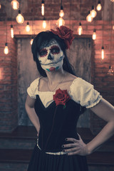 Toned photo of zombie girl with white make-up on her face