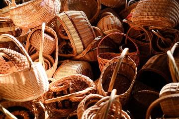 Pile of handmade vine baskets on a market