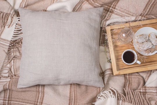 Natural color linen pillow, cushion Mockup on plaid. Inrerior photo