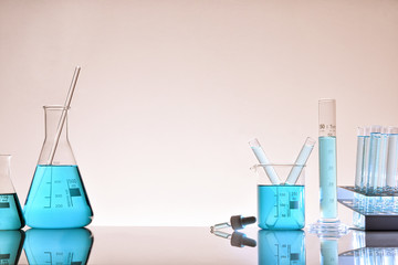 Assortment of glass containers for laboratory warm background general view