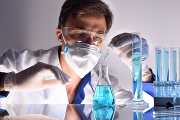Chemical worker testing different substances behind a laboratory table