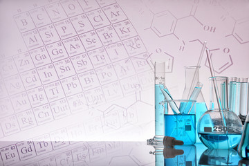 Glass chemical containers with blue liquid and background with representation