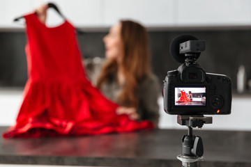 Pretty young girl recording her video blog episode