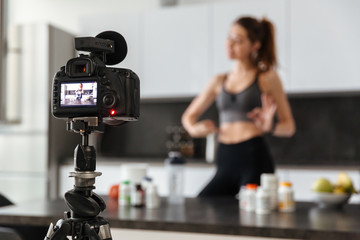 Happy healthy young girl recording her video blog episode