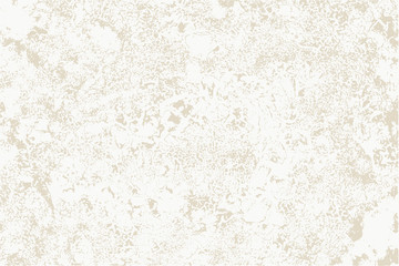 Worn plaster on beige surface.
