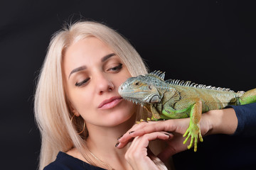 Beautiful girl portrait and green iguana