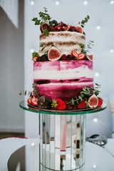 Rustic wedding cake decorated with figs and greenery