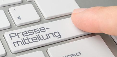 Tastatur mit beschrifteter Taste - Pressemitteilung