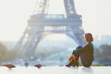 Girl in Paris near the Eiffel tower at morning
