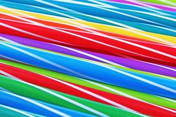 Fancy straw art background. Abstract wallpaper of colored fancy straws. Rainbow colored colorful pattern texture. Rainbow background abstract pattern.