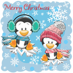 Two Cute Penguins on the snowflakes