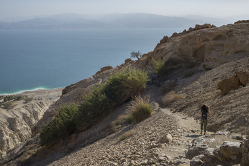 Teenage girl walking on trail, Dead Sea Region, Israel