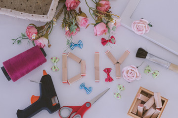 Flat lay hand craft Materials with DIY wooden wording