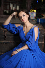 elegant woman in retro style in a blue dress