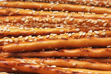 Bread sticks cracker texture pattern. Salted bread sticks as background.