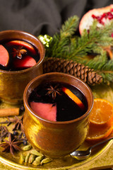 Warm mulled wine for Christmas days, prepared with apple, orange and spices.