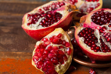 Healthy fruit red ripe pomegranate, rich of Vitamin C, also known as a symbol of prosperity, fertility and used in traditional medicine