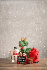 Christmas holiday background with Santa and decorations. Christmas landscape with gifts and snow. Merry christmas and happy new year greeting card with copy-space.