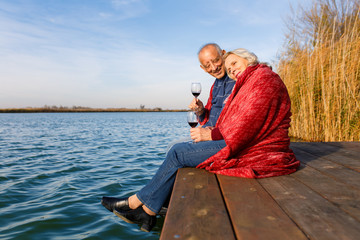 Happy senior couple enjoying time together by the lake.