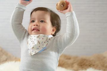 Sweet Beautiful baby girl playing on beautiful white furry.Newborn baby concept.Joyful.Happy.Excited.