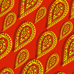 Indian oriental seamless pattern in yellow drops on a red background in ethnic style for decorating fabrics or textile